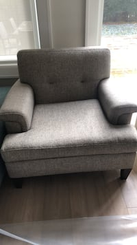 gray fabric sofa chair with throw pillow 523 km