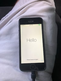 Black iphone 5 with grey and black case Sumter, 29154