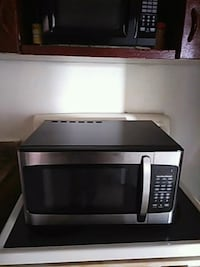 stainless steel and black microwave oven Philadelphia, 19138