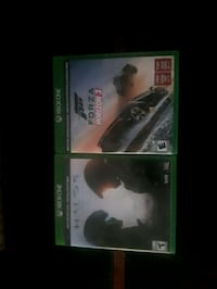 two Xbox One game cases Dollard-des-Ormeaux, H9B 2A3