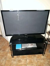 black flat screen TV with remote  Halifax
