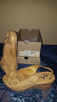 pair of beige sling back open-toe wedge sandals Great Falls, 59401