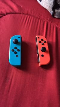 two blue and red Nintendo Switch game controllers Greeley, 80631
