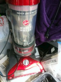 red and black hoover upright vacuum cleaner