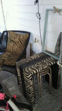 two brown-and-black zebra print sofa chairs Seminole, 33778