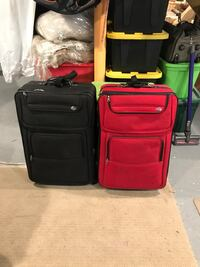 two black and red softside luggage's
