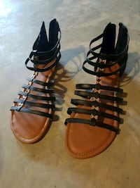 pair of brown leather strappy sandals Edmonton, T6W 0C3