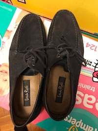 pair of black Sperry boat shoes 691 mi