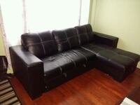 Black leather L shape couch  Brossard, J4W 1Z6