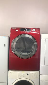 red front-load clothes washer Montreal, H2G 2X3