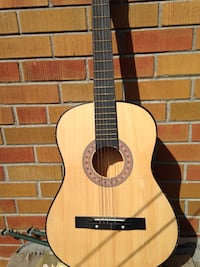 Brown and black acoustic guitar Toronto, M9P 1K3