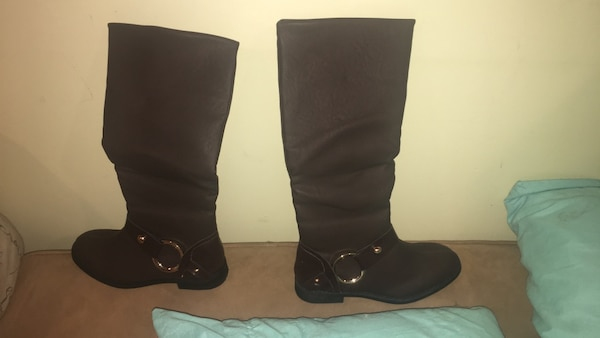 Pair of brown fake leather knee-high boots
