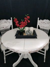 Kitchen table with extra leaf and 4 chairs refinished beautiful detail