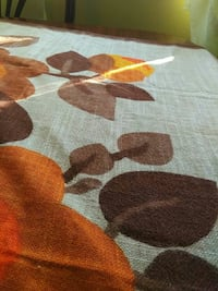 white, brown, and orange floral table cloth Longueuil, J4J 3T8