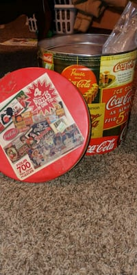 Vintage coca cola tin can with 4 puzzles Norman