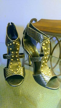 pair of studded black Guess leather open-toe ankle strap heeled