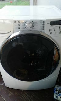 white and silver-colored front-load washing machine