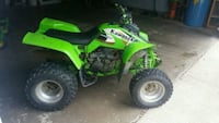 green and black Kawasaki ATV Richmond, 47374