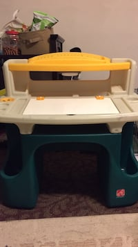 toddler's green, yellow, and gray plastic pedestal desk 376 mi