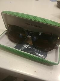 black New Balance sunglasses with brown frame
