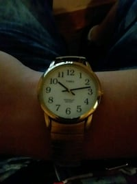 round gold-colored analog watch with black leather strap Gaffney, 29340