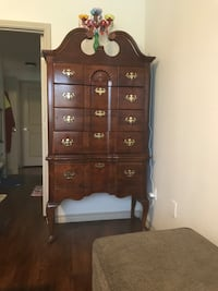brown wooden 5-drawer tallboy dresser