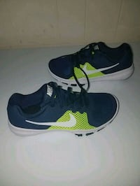 pair of blue-and-green Nike running shoes Houston, 77041
