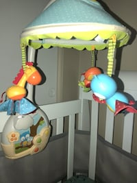 White, red, and green fisher-price crib  Rockville, 20853