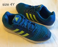 blue-and-yellow Adidas low-top shoes