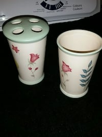 two white and red ceramic mugs