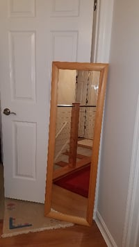 •	Rectangle full length mirror with natural wooden frame in good condition, $22