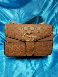 brown monogrammed Coach leather wristlet Los Angeles, 91402
