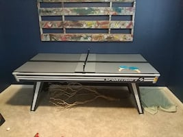 gray and black wooden ping pong table