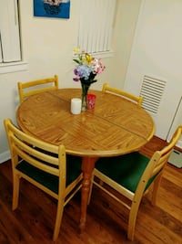 Round brown wooden table with four chairs dining s Gaithersburg, 20878
