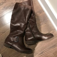 pair of brown leather side-zip knee-high boots
