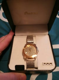 round gold analog watch with link bracelet in box Fairchance