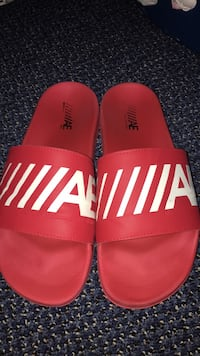 pair of red Adidas slide sandals Guelph, N1H 6R3