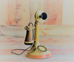 Working candlestick phone/reproduction.  Unused.  Only used as prop