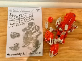 Solar powered robot transformer building toy