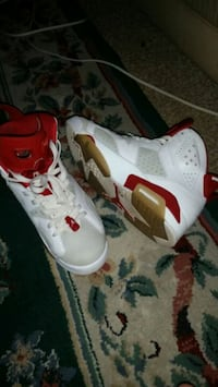 pair of white-and-red Air Jordan shoes 29 mi