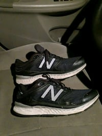 pair of black-and-white New Balance sneakers 46 mi