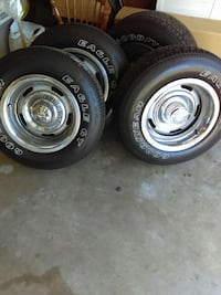 two gray bullet hole car wheels with tires Henderson, 42420