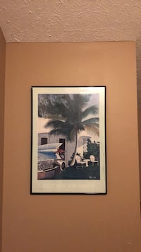 Black wooden framed painting of car and palm tree Westerville, 43082