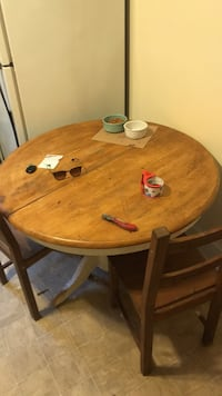 round brown wooden table with four chairs dining set Fairfield, 06824