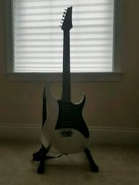black and silver electric guitar 24 km