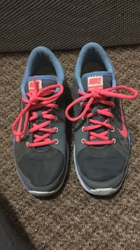 pair of black, red, and blue Nike running shoes Quinte West, K8V 6S8