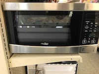 Gray and black stainless steel microwave oven