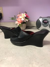 Pair of black leather wedges .  Tommy Hilfiger Annapolis