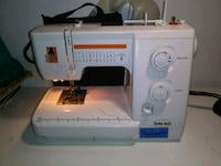 white Singer electric sewing machine New York, 10016