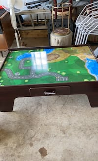 Imaginarium train table and trains plus extra train parts. Smoke free